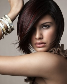 A sultry look can be achieved with an asymmetrical hair style.